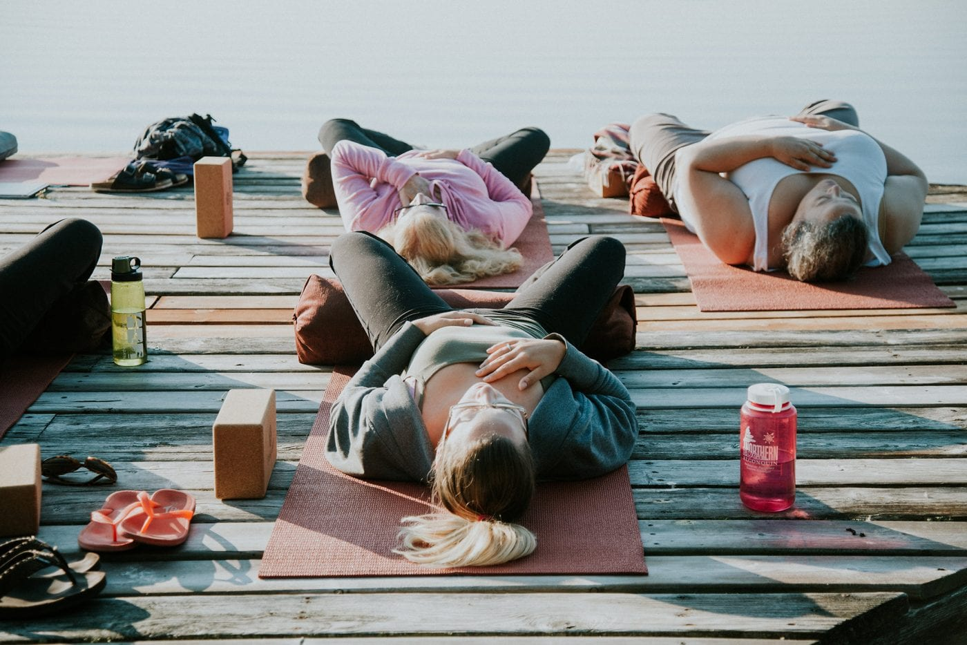 Laying on the dock and doing yoga with a group