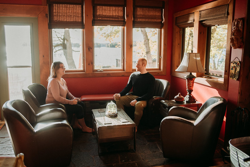 Man and woman chat in cafe style lounge area
