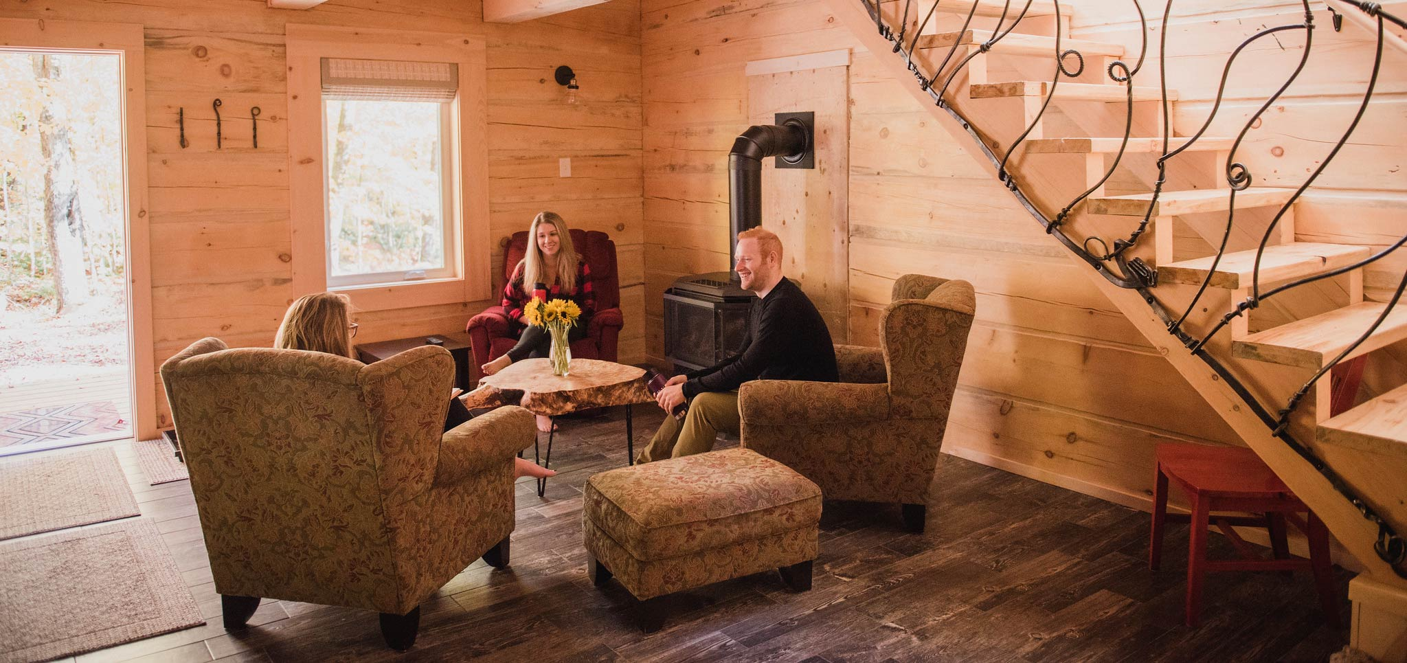 Friendly discussion by the fire in a modern log cabin