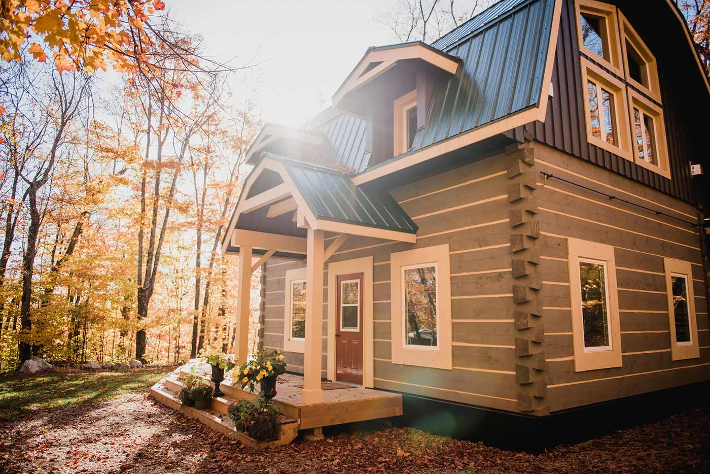 Beautiful log cabin surrounded by fall foliage in the woods