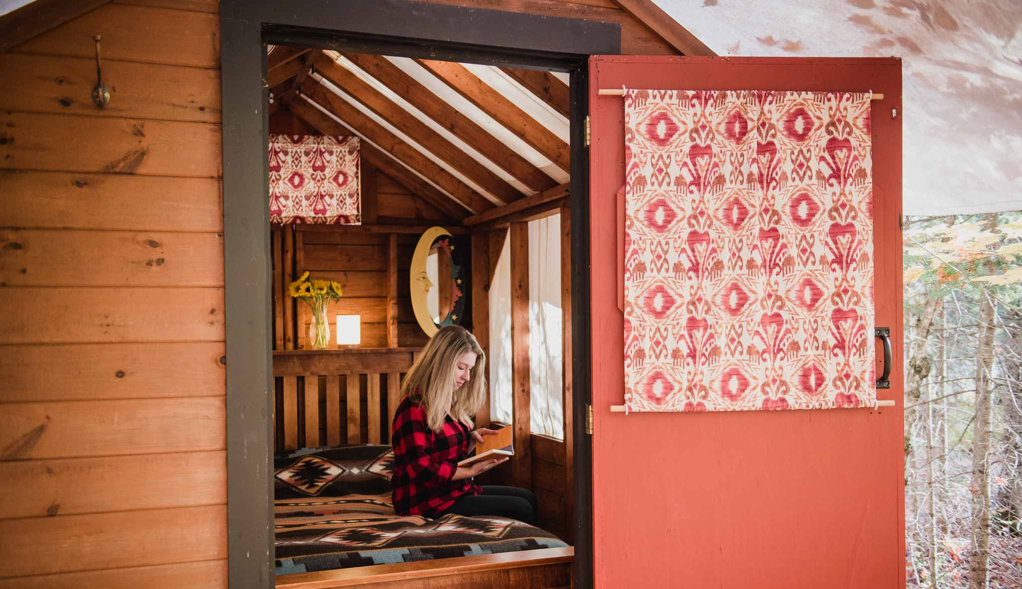 Girl reading a book in a cabin