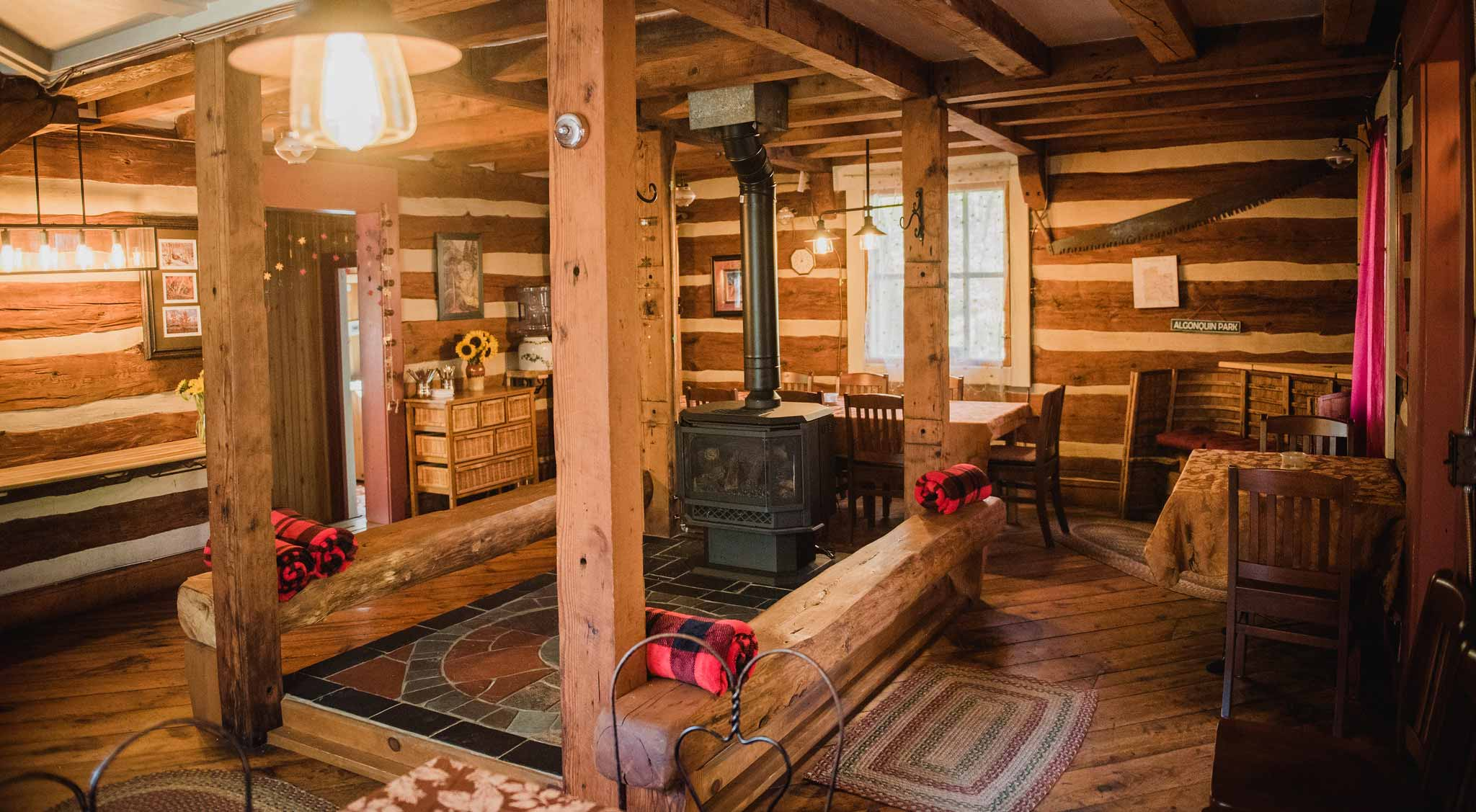 Cozy log cabin interior with a fireplace