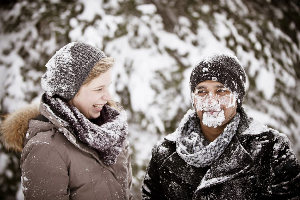 winter fun snow in face couple