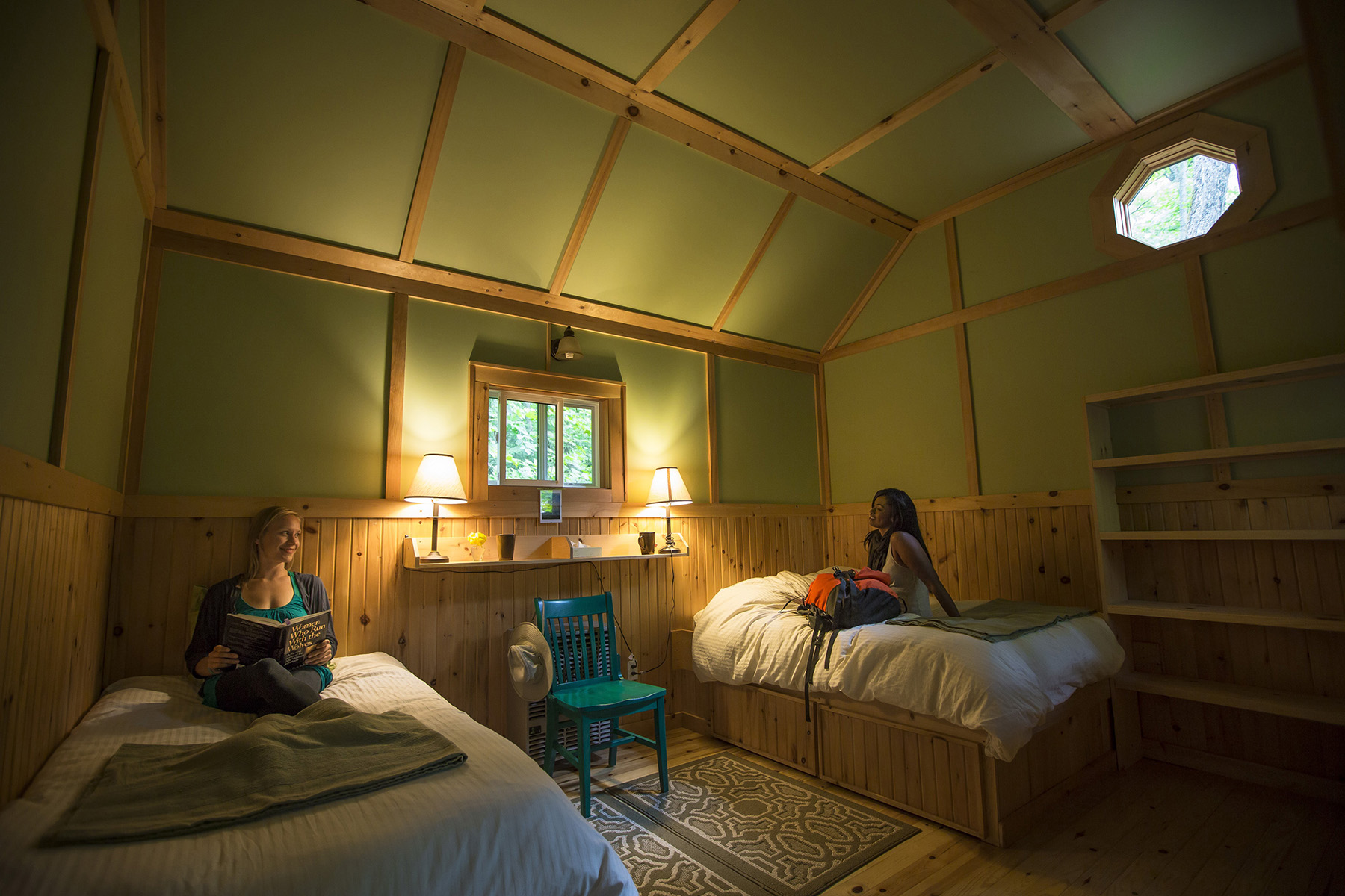 Two girls sitting in beds in a private cabin