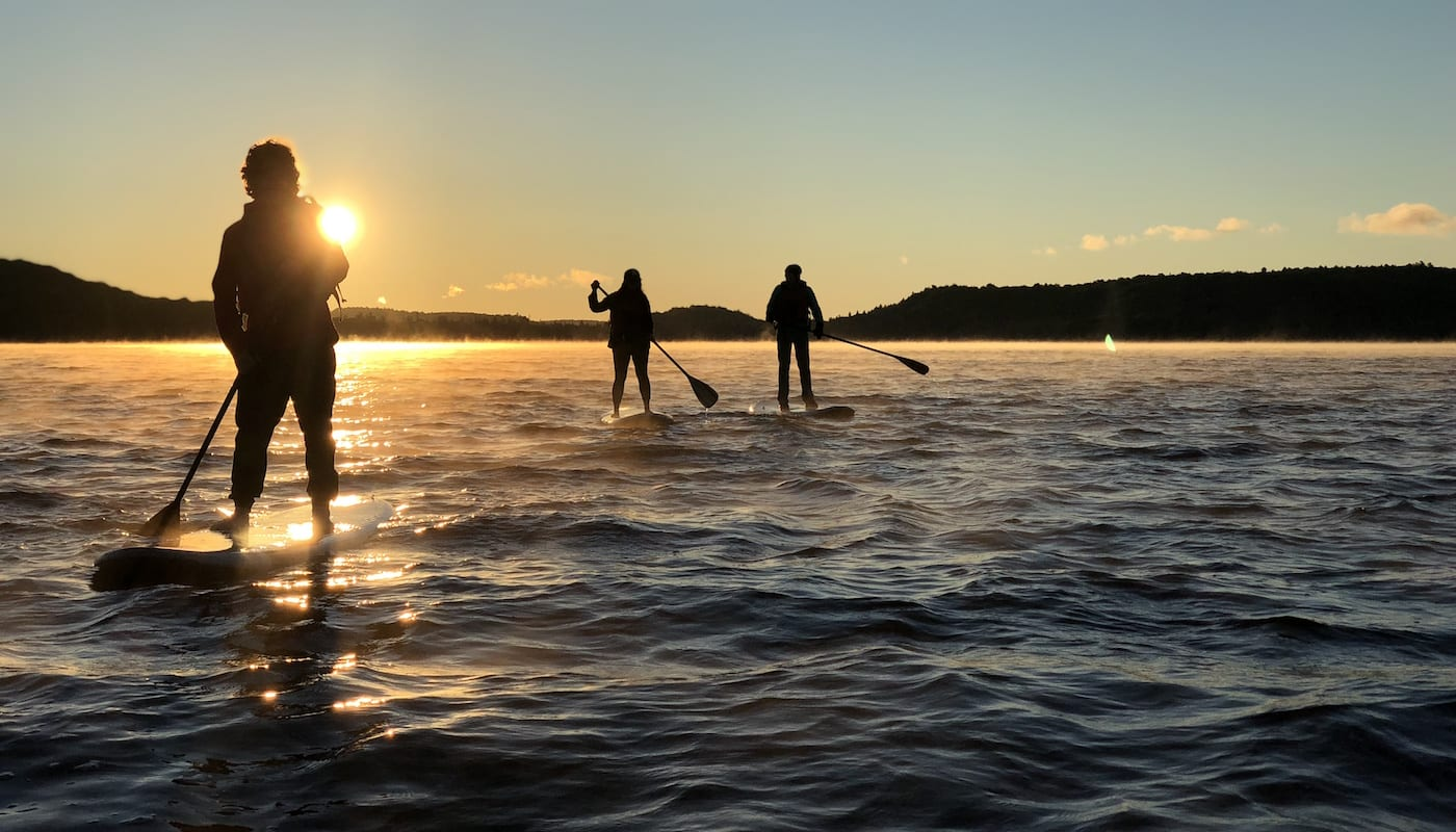 Three women on standup paddle boarding on the lake
