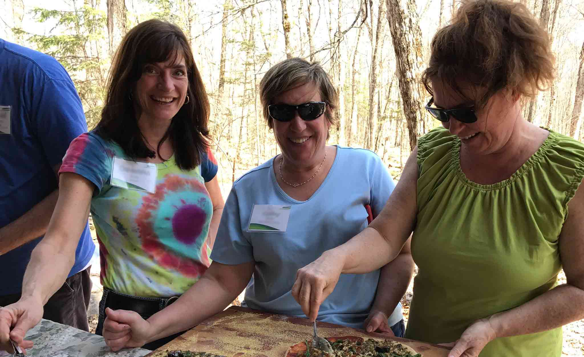Three women are eating a buffet style meal